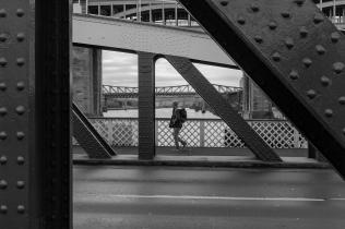 I've shot similar before, but love this arrangement of spectacular bridges dwarfing people.